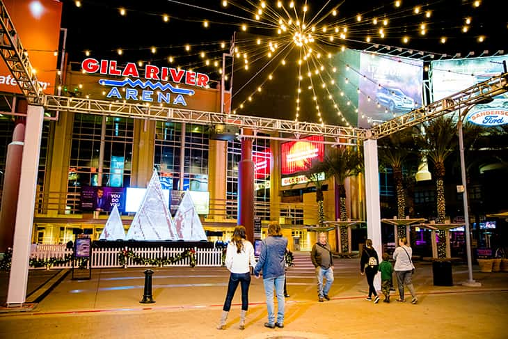 People in front of the Gila River Arena entrance